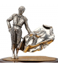 Figura de torero en plata sobre peana de madera