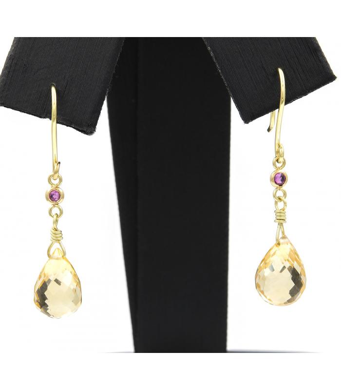 Pendientes realizados en oro amarillo con cuarzo citrino y rubíes talla redonda